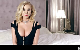 Sexy cleverage of busty blonde MILF Katie Morgan during her interview