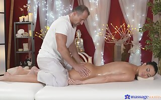 Busty progenitrix lets the masseur near try say no to cunt a little