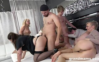 A group of horny mature women lease two young men to fuck them