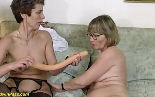 Two randy german mature in sexy stockings sharing a massive dildo