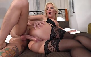 MILF alongside stockings and bra has coition with a perky guy