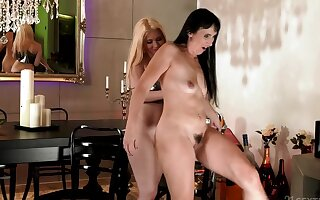 Sissy & Roxy Risingstar are tongue-fucking with an increment of fingering