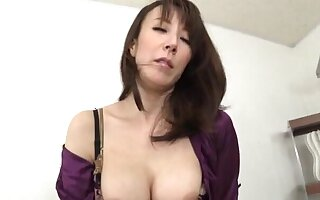 Horny Japanese MILF takes off say no to clothes with the addition of rides a dildo
