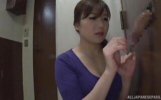 Aroused Japanese mom loves a good gloryhole XXX play at home