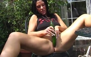 Shaved pussy mature slut Crystel Lei loves having fun with a cucumber