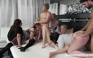 Naked women share dicks in crazy group scenes at home