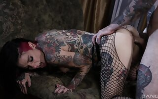 Tattooed couple having nasty sex on the bed with facial ending