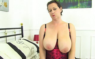 Mature granny Eva Jayne gets naked and plays with her cunt and ass