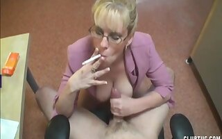 Horny dude jerks off while at work and his mature boss makes him cum
