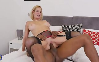 Molly Maracas is sucking a big, black dick and getting it straight inside her shaved pussy