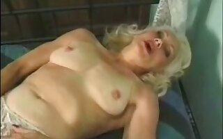 Grown-up auburn whore masturbates her wet old pussy with a toy